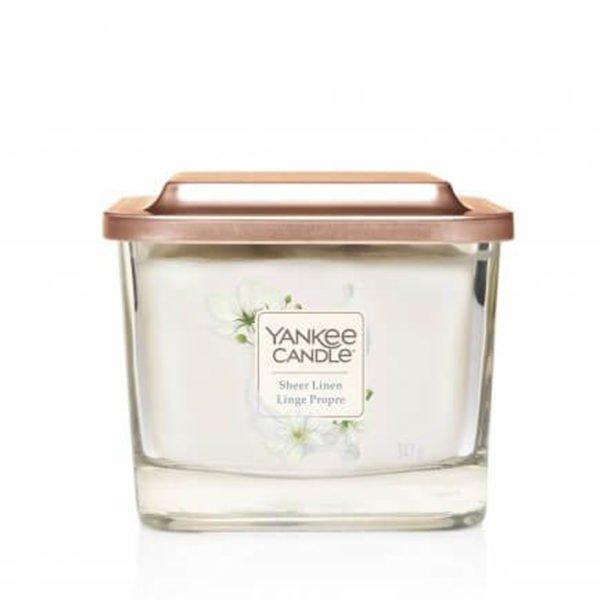 średnia świeca zapachowa od Yankee Candle, biała o zapachu sheer linen. czysta pościel, len, kwiaty, zapachy,świeca zapachowa, świeca, czystość, prezent, yankee elevation, wosk sojowy