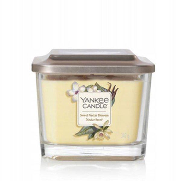 Średnia świeca zapachowa od Yankee Candle, żółta w szklanym słoiku o zapachu Sweet Nectar Blossom. Elevation Yankee Candle, świeca, świeca zapachowa, wosk, żółta, kwiaty, wanilia, kokos, bursztyn, konwalia, gruszka, słodkie, słodycz, dla pań, dla pana, na prezent