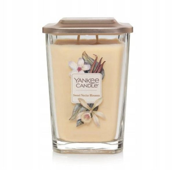 Duża świeca zapachowa od Yankee Candle, żółta w szklanym słoiku o zapachu Sweet Nectar Blossom. Elevation Yankee Candle, świeca, świeca zapachowa, wosk, żółta, kwiaty, wanilia, kokos, bursztyn, konwalia, gruszka, słodkie, słodycz, dla pań, dla pana, na prezent