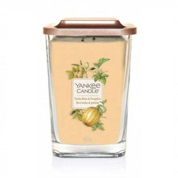 Duża świeca zapachowa od Yankee Candle, żółta w szklanym słoiku o zapachu Tonka BEan Pumpkin. Dynia, dyniowy, kwiaty, drzewa, jesień, liście, słodkie, przyprawy, zapachy, świeca zapachowa, wosk, cytrusy, pieprz, zieleń, halloween, prezent, wosk sojowy